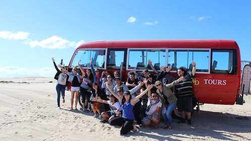 Group in front of tour bus at Stockton Bright Sand Dunes
