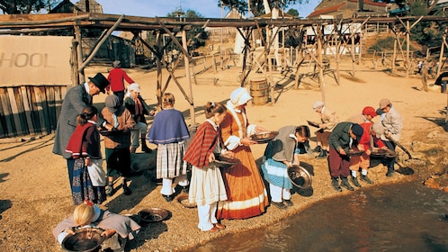 Townspeople in costume panning for gold at Souvereign Hill in Australia