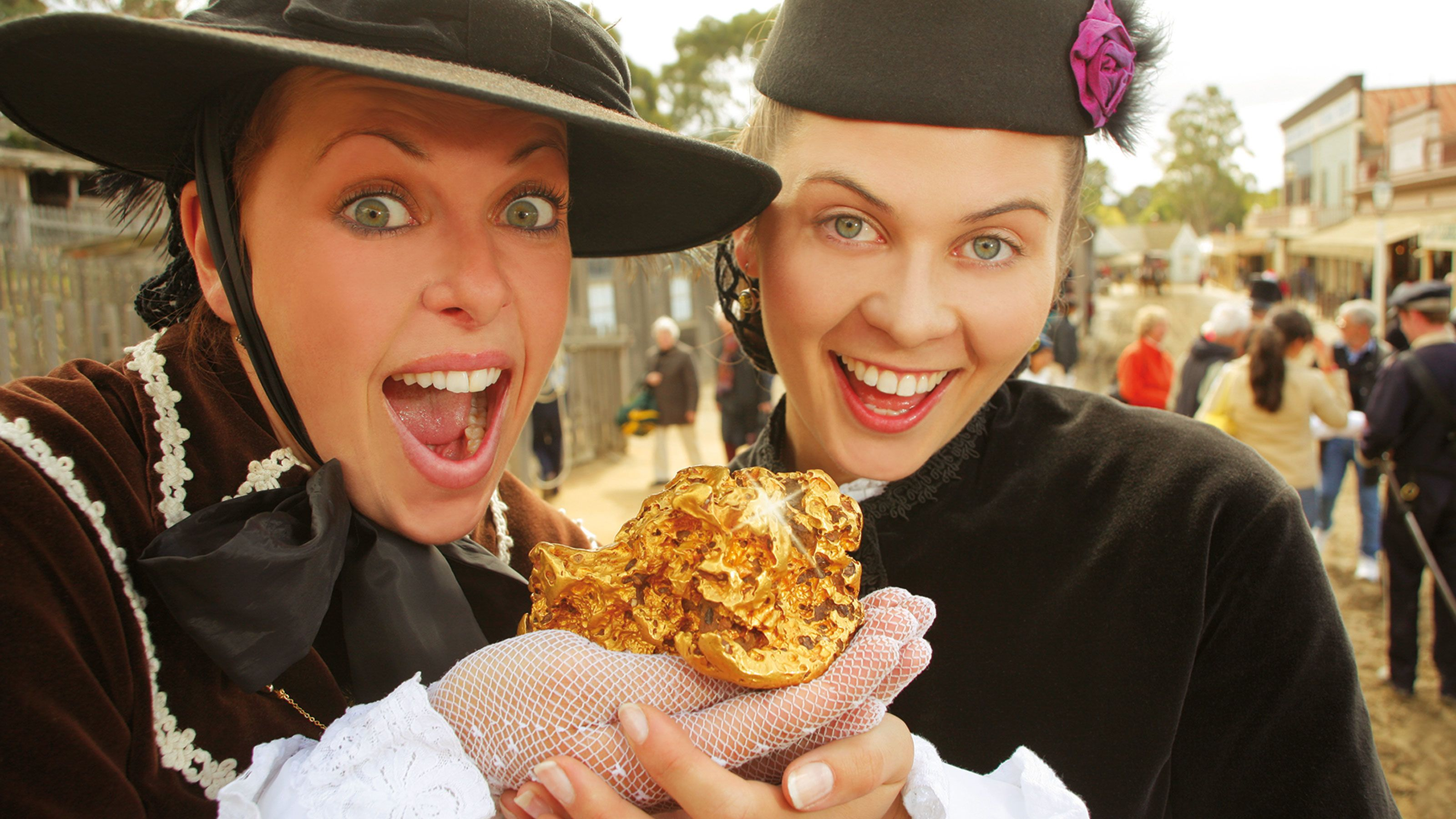 Women in costume holding prop gold at Souvereign Hill in Australia