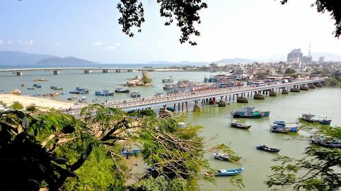 Scattered boats along a long bridge in Nha Trang