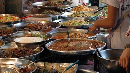 Preparing street food at the market in Bangkok