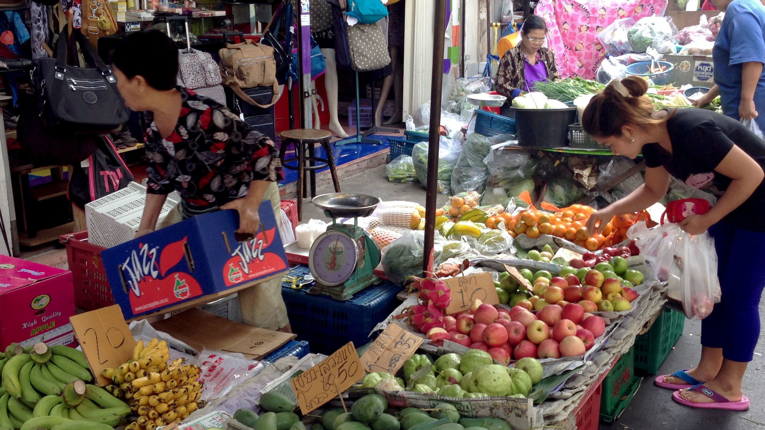 Shopping for local produce at the market in Bangkok
