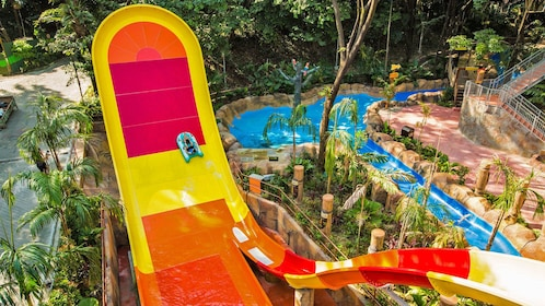 raft splashing down brightly colored waterslide
