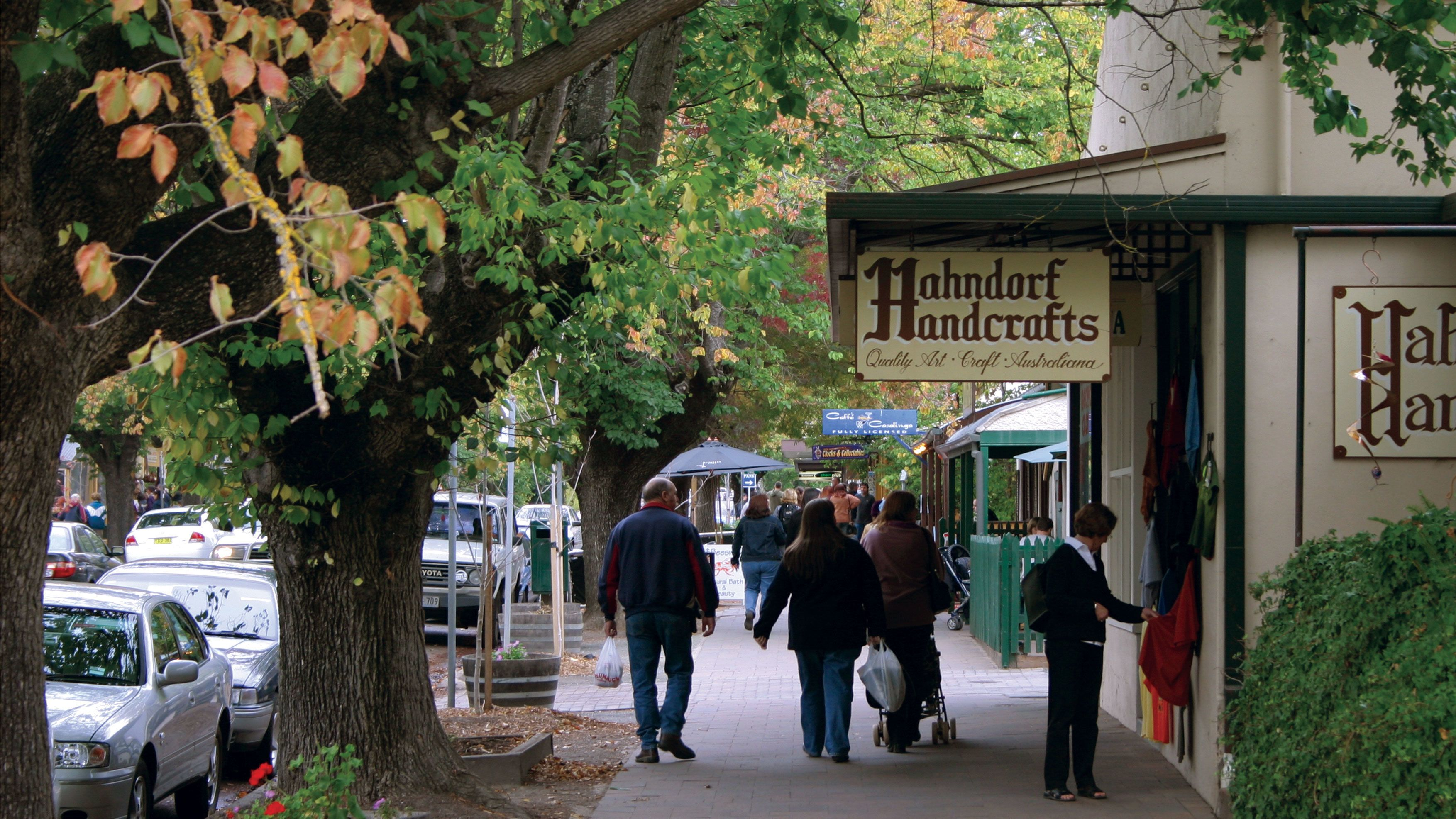 Shops and trees line the sidewalk in Hahndorf
