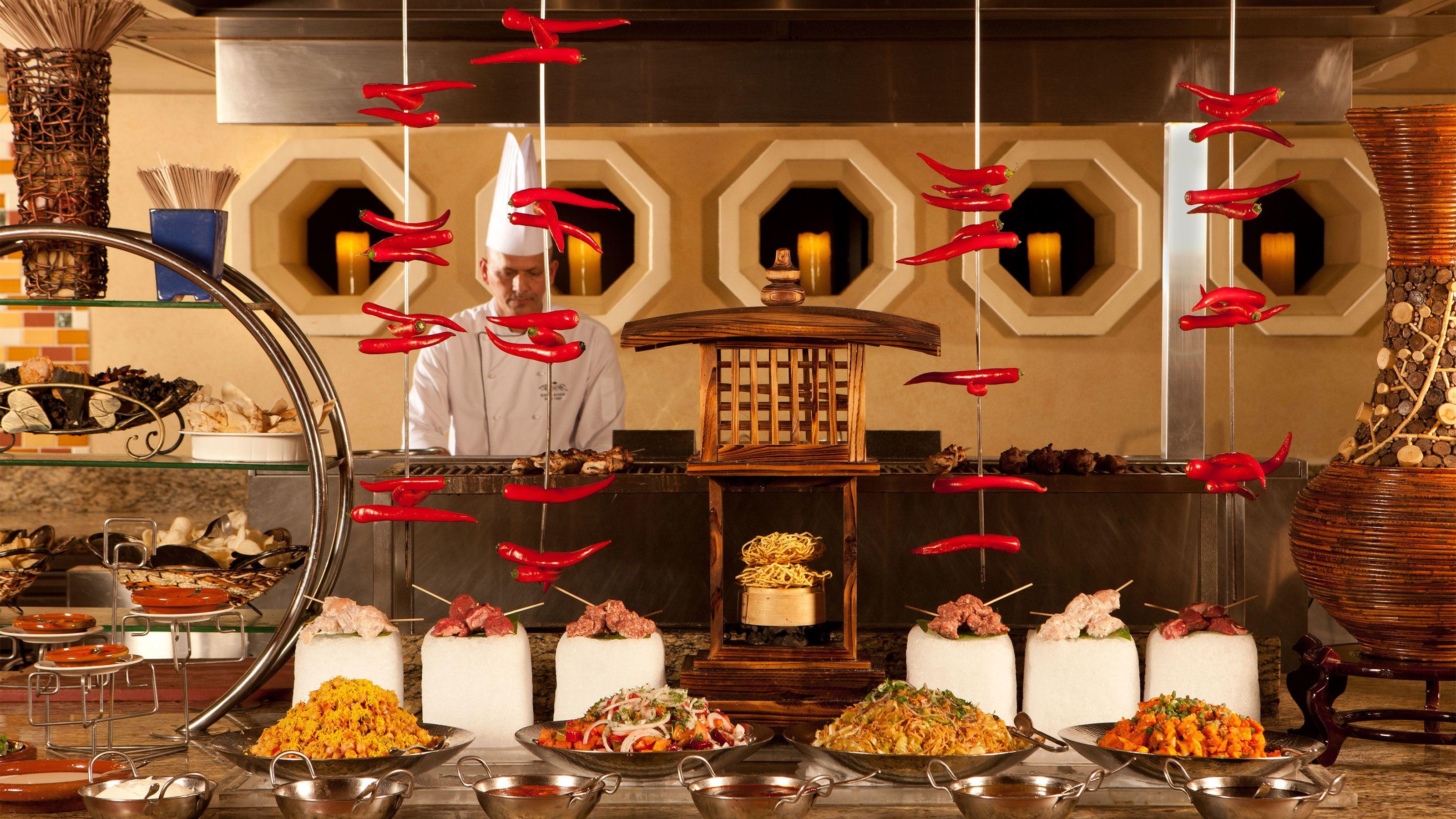 chef preparing food at Atlanyis buffet in Abu Dhabi