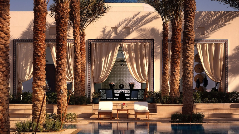 Show item 1 of 5. palm trees and swimming pool at spa in Abu Dhabi