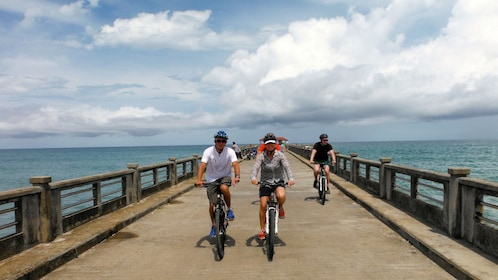Tourists biking along the waters of Phuket Island in Thailand