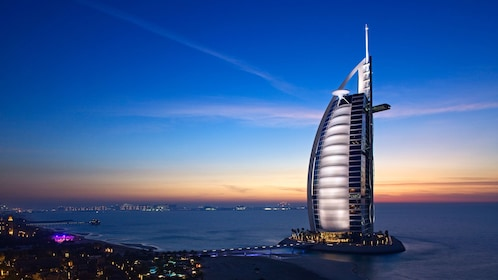 night scape panoramic view of Burj Al Arab hotel in Abu Dhabi