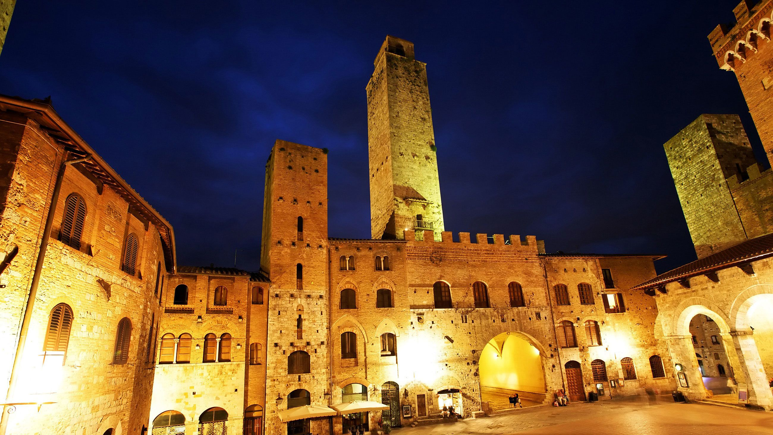 illuminated stone buildings in Italy