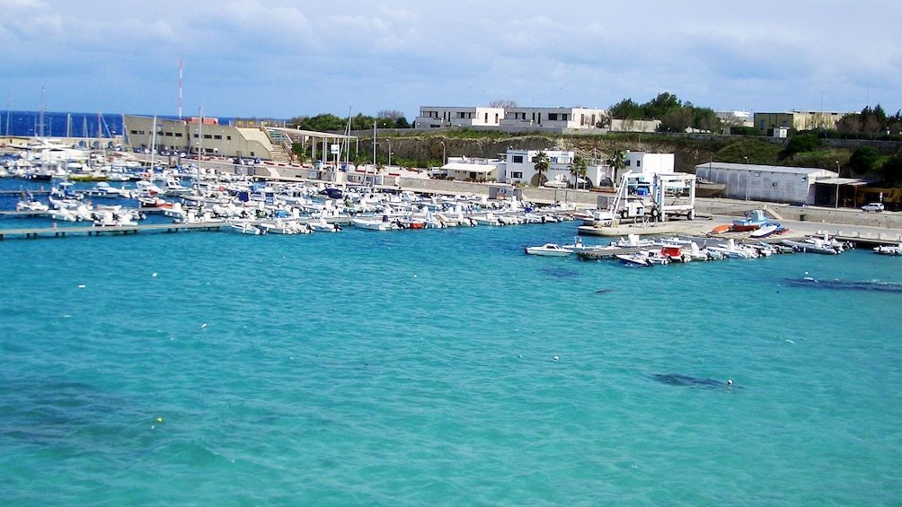 Apri foto 2 di 6. boats docked at the beachfront of Otranto