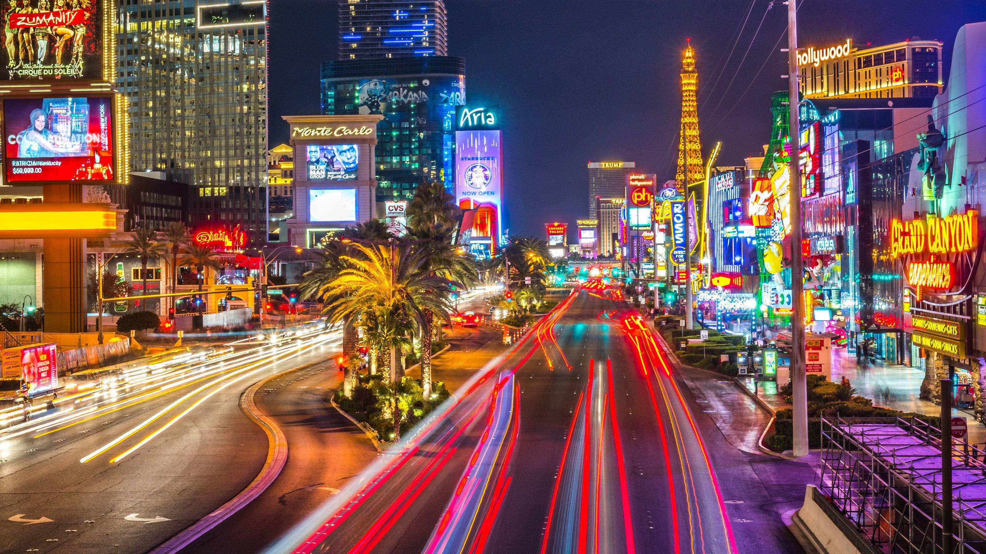 Las Vegas street at night with neon lights.