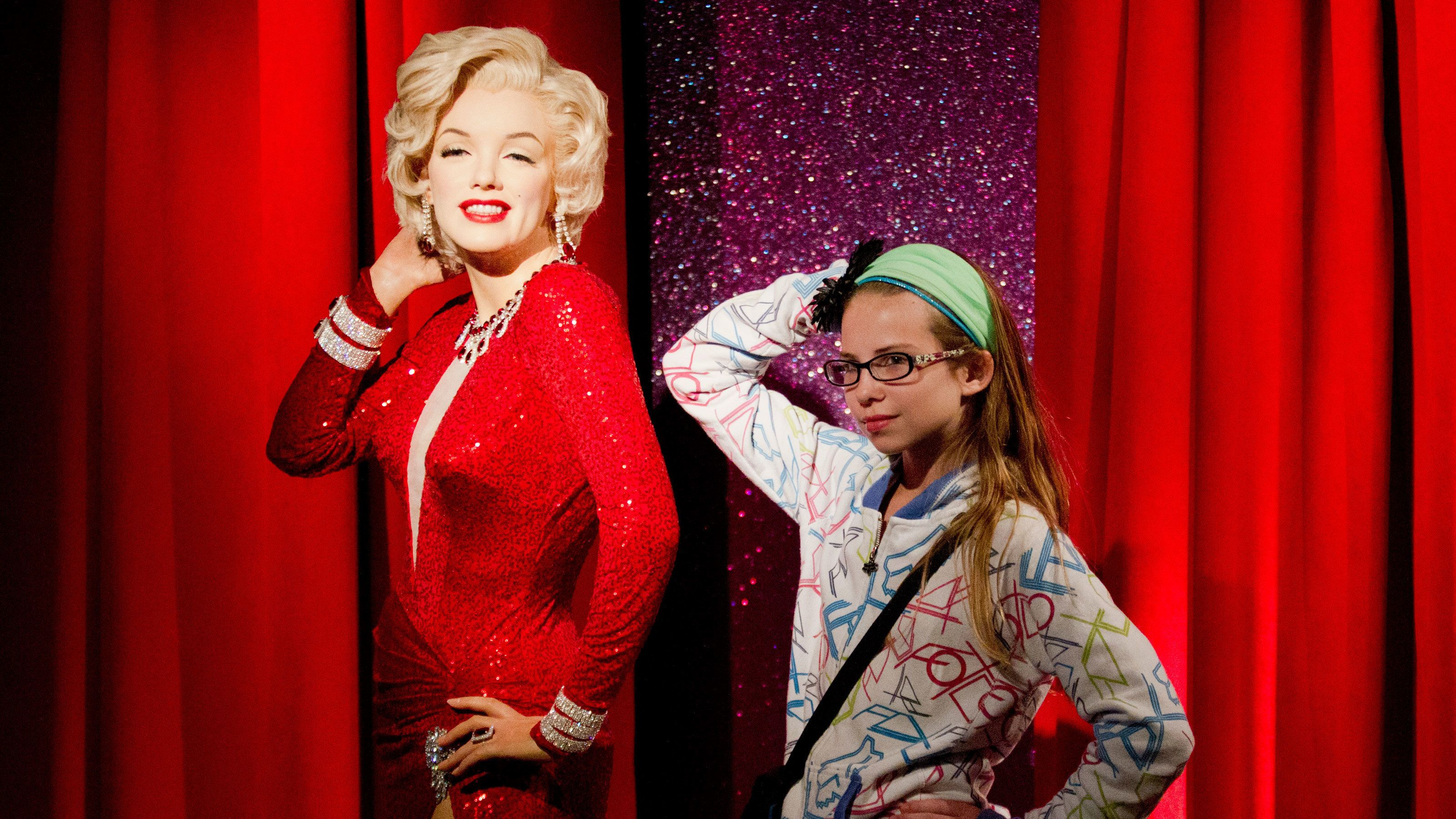 Girl posing with Marilyn Monroe wax figure at Madame Tussauds in San Francisco