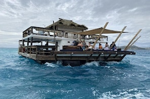 Experience Cloud 9 Floating Beach & Bar Plus Onshore Hot Spring Mud Pool Co...