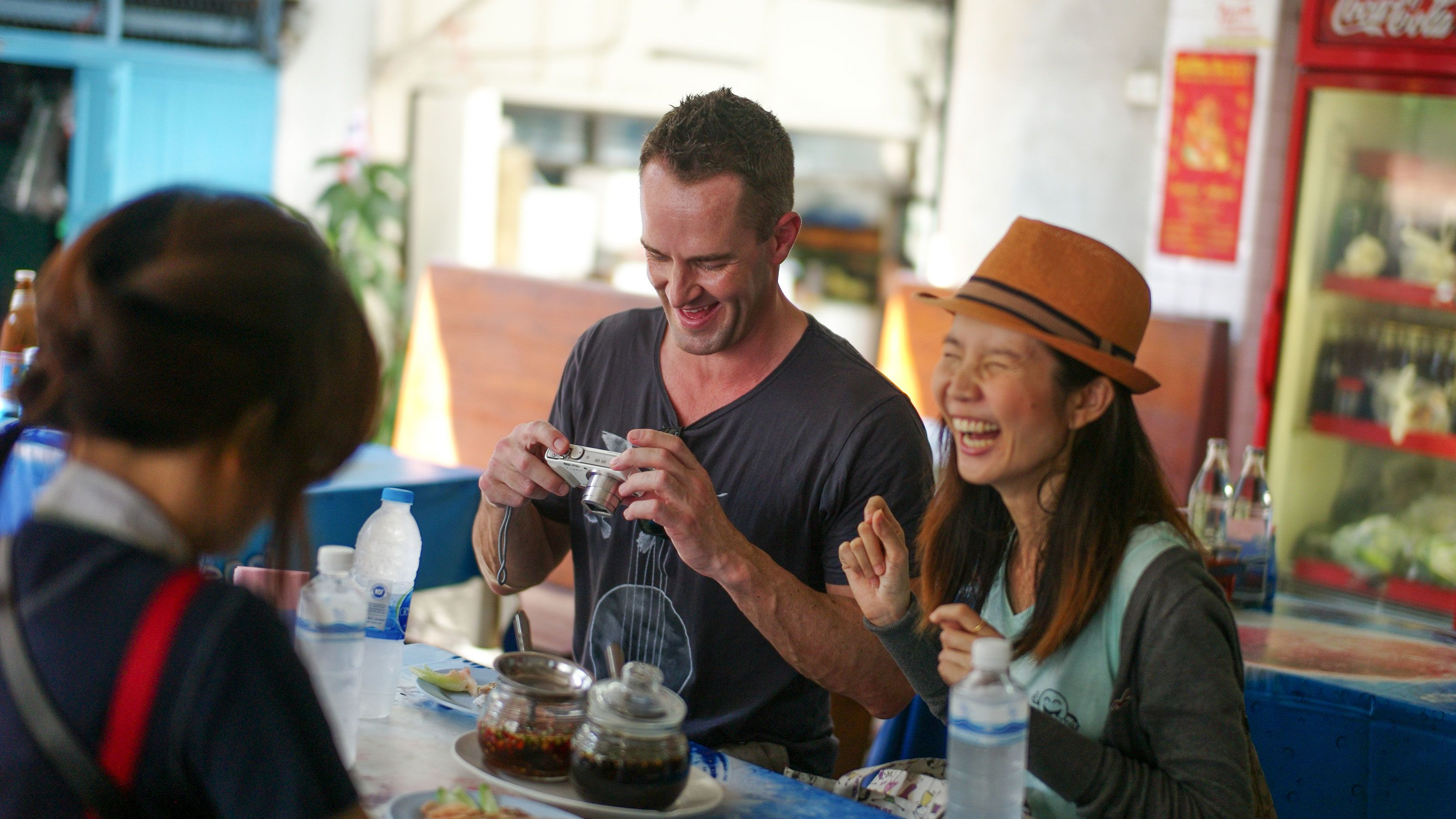 Enjoying street food in the market of Bangkok