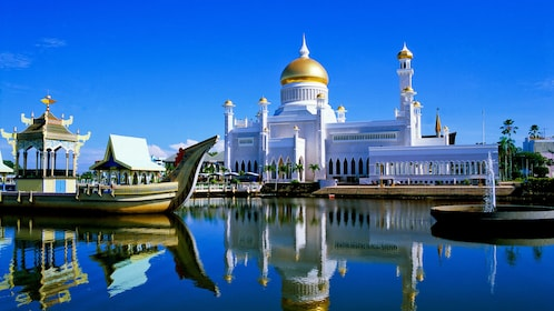 Day view of the Istana Nurul Iman with clear blue skies
