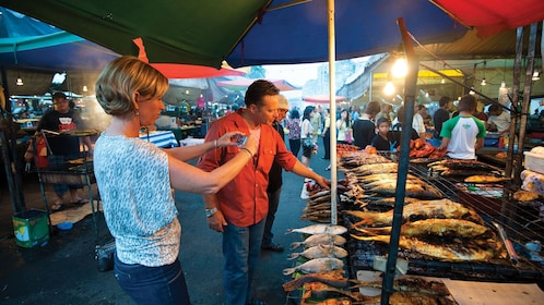People enjoying the sights of the Gadong Night Market