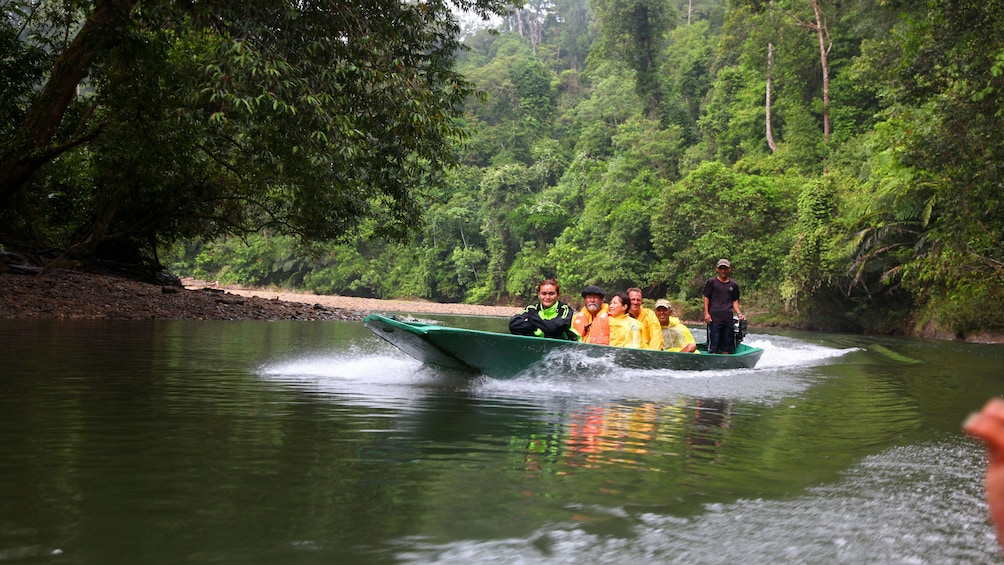 Show item 5 of 5. Tour group sailing on the water at Ulu Temburong National Park