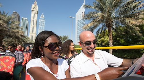passengers aboard tour bus looking at map in Abu Dhabi