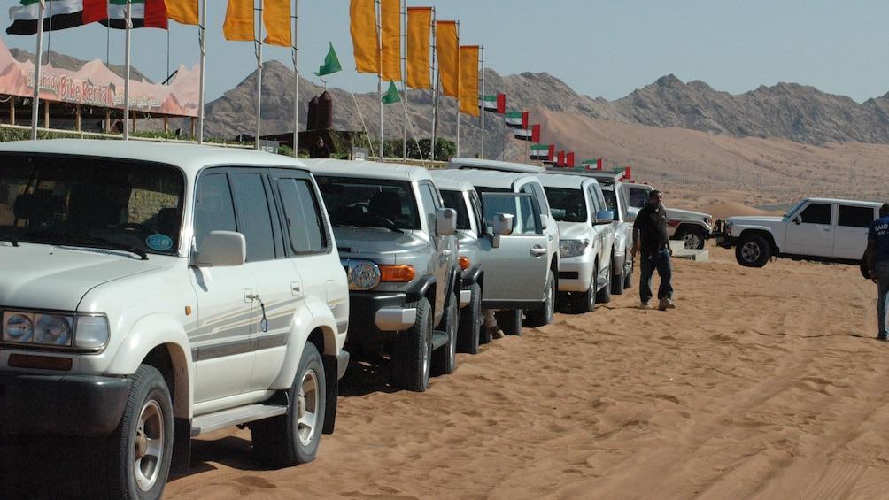 Show item 8 of 8. Line of SUVs near tents in Dubai