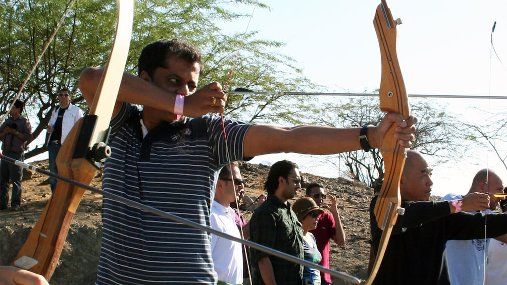 Show item 4 of 5. man at archery competition in Abu Dhabi