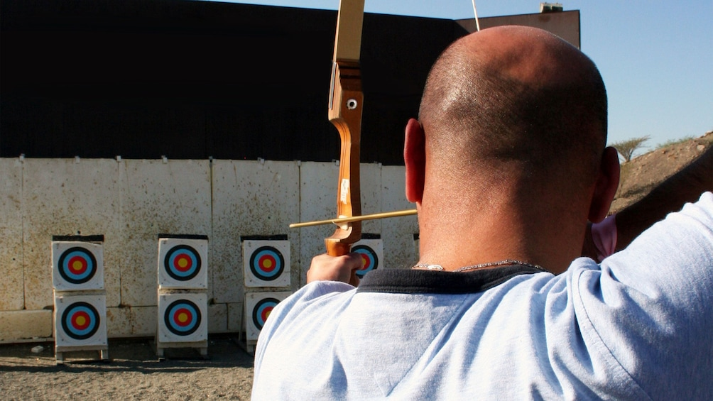 Show item 5 of 5. man at archery competition in Abu Dhabi