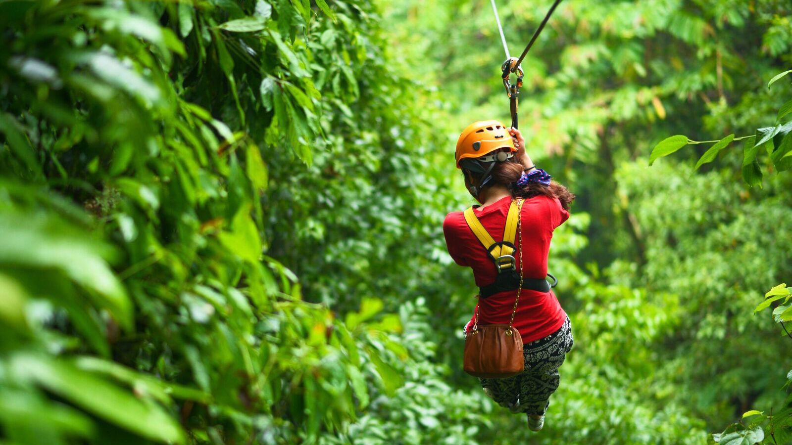 Woman ziplining in Thailand