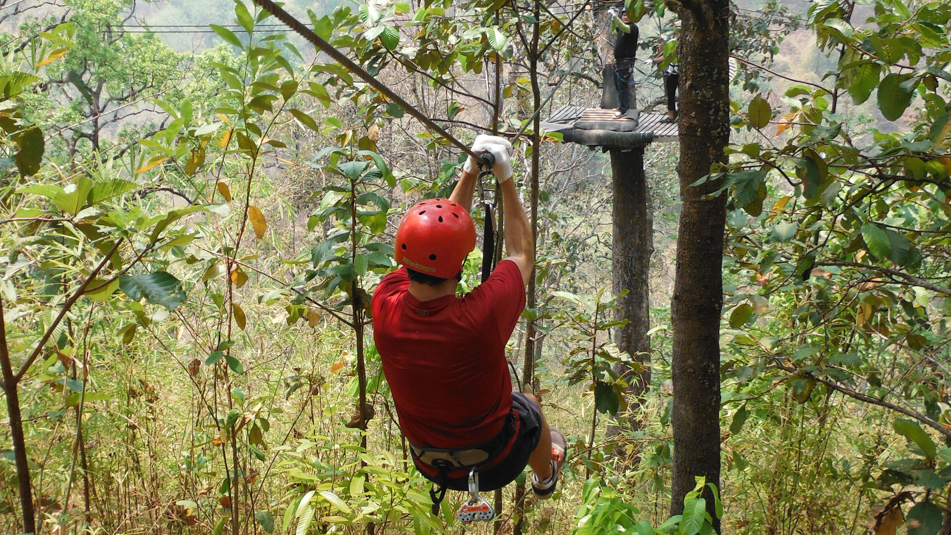 Man ziplining through Chiang Mai's Mae Taeng district