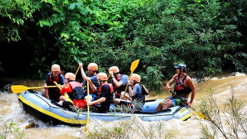 Rafting group heading down river in Thailand