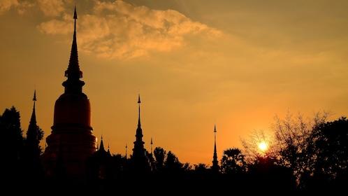 Sun setting over temples in Bangkok