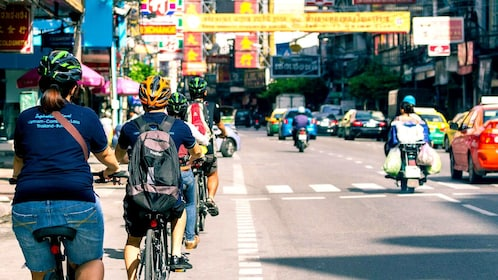 Bicycle riding down street in Bangkok