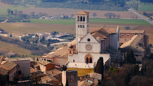 Basilica of St. Francis high in the hills overlooking the valley below in Assisi