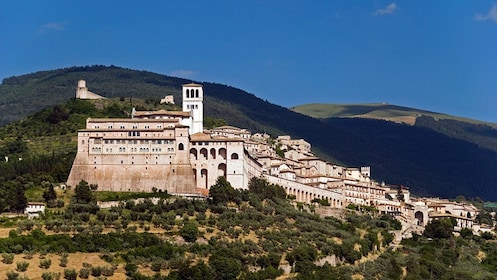 Basilica of St. Francis of Assisi with rolling hills in the background