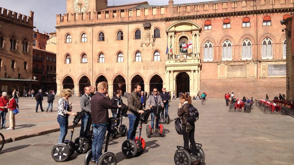 Segway group in front of the Palazzo d'Accursio in Piazza Maggiore in Bologna