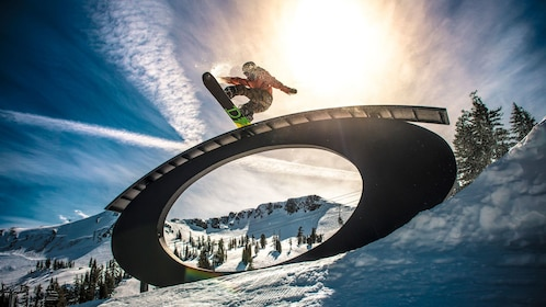 snowboarder jumping in tahoe