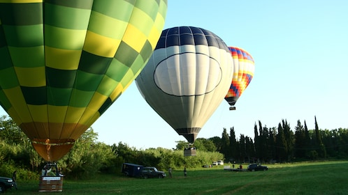 Three colorful hot air balloons taking off