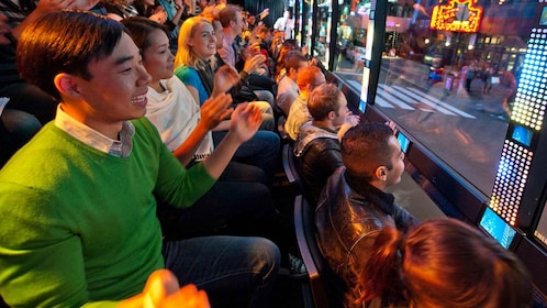 Passengers on The Ride tour bus in New York