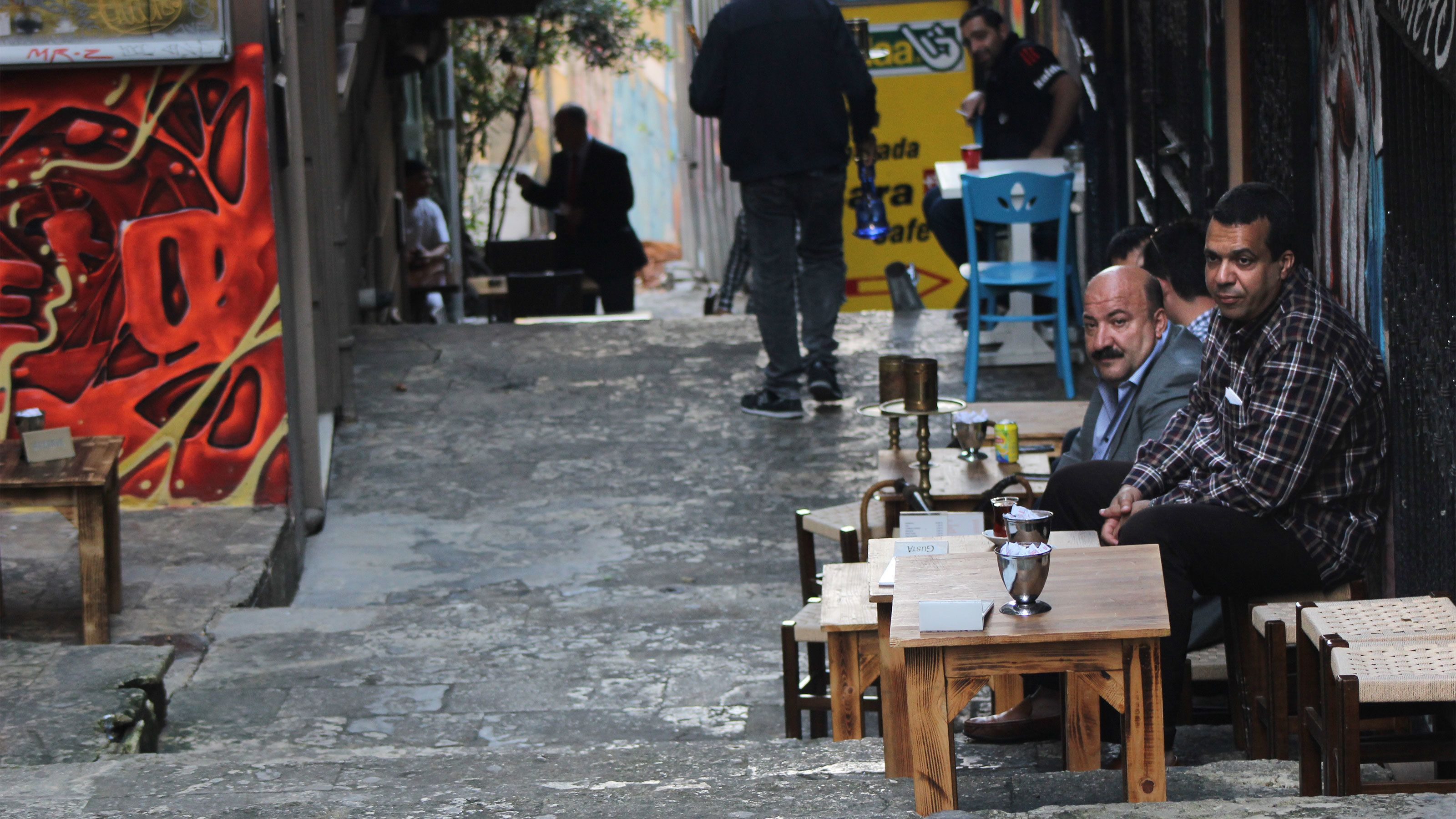 Men enjoying coffee at a neighborhood coffee shop in Istanbul