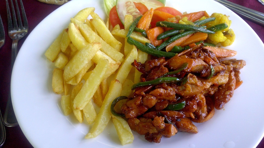 Show item 2 of 4. Meat vegetable and fry dish in Nairobi
