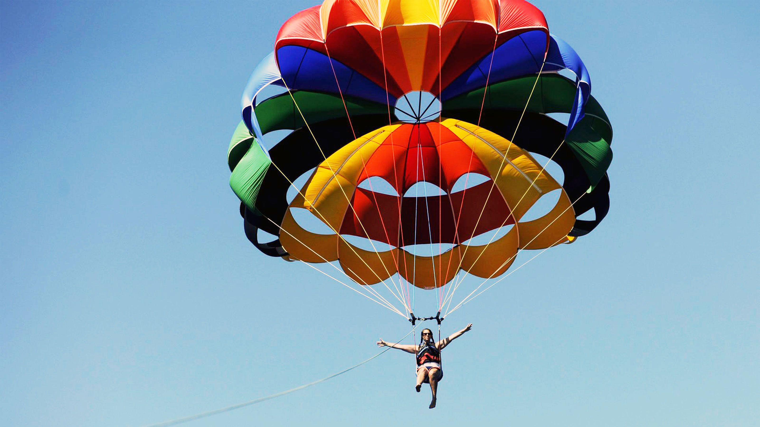 Colorful parachute and parasailers in Dubai