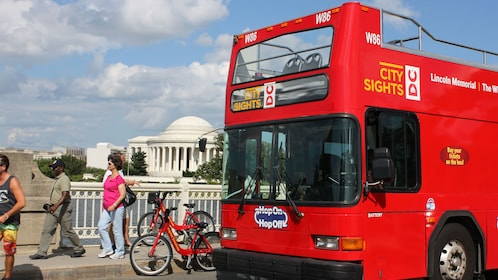Hop-On Hop-Off bus parked with the Jefferson Memorial in the background in Washington DC