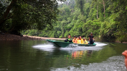 Group sailing down the water at the Ulu Temburong National Park
