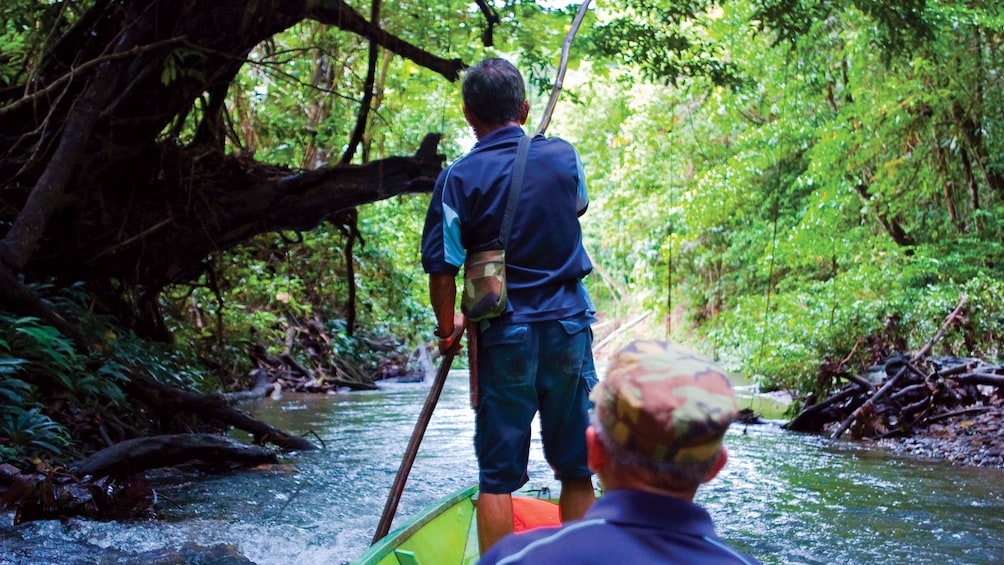 Show item 5 of 5. Man enjoys a scenic float down the river at Ulu Temburong National Park