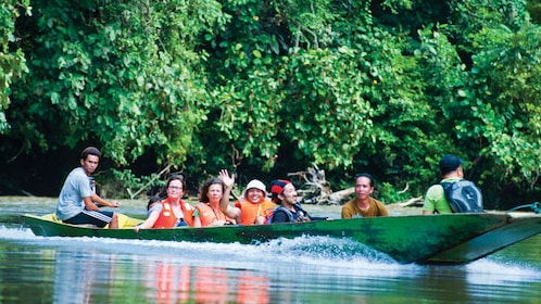 Group on a scenic cruise aboard a traditional Bruneian longboat in Bangar