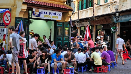 Crowded eatery outside the store in Hanoi