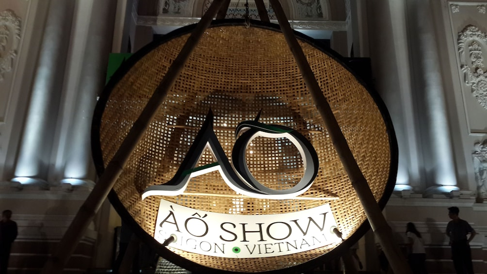 Show item 4 of 9. Sign outside the A O Show Saigon in Ho Chi Minh City