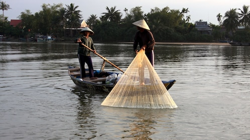Locals in Hoi An fishing in Vietnam