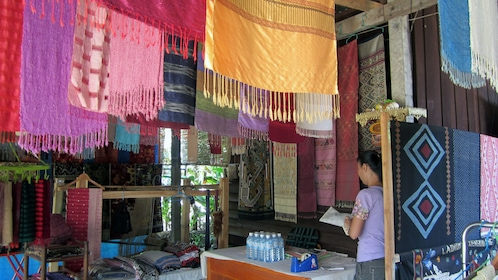 Colorful silk scarves for sale at a village in Laos