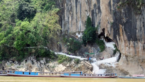 View of stairs into a cave from the Mekong river