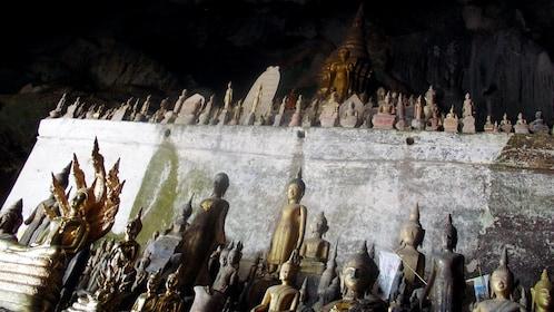 An assortment of Buddha statues inside the Pak Ou Caves