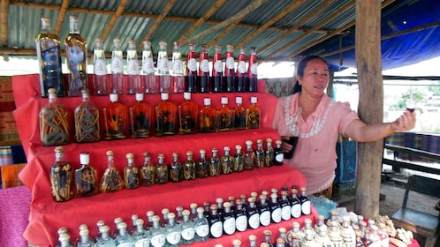 A woman selling ancient remedies just outside the Pak Ou Caves